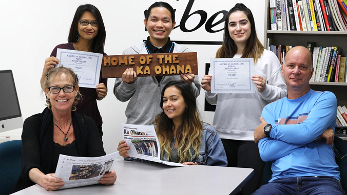 Ka Ohana staff holding newspaper and award