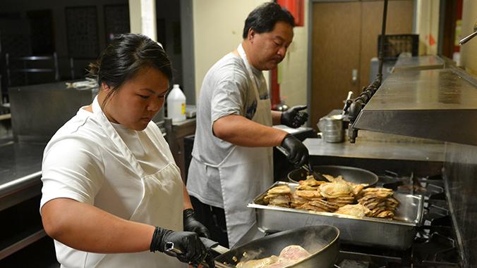 Hawaii C C people preparing food