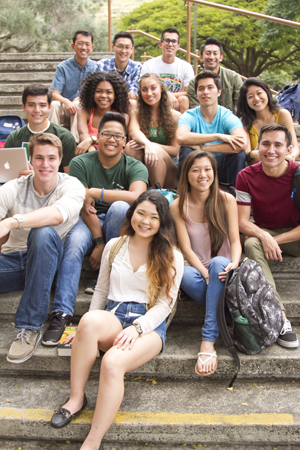 group of UH Manoa students sitting on steps