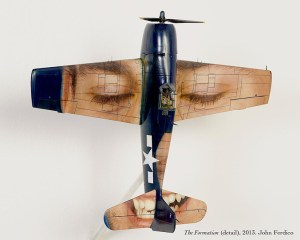 airplane art with face on wings and tail
