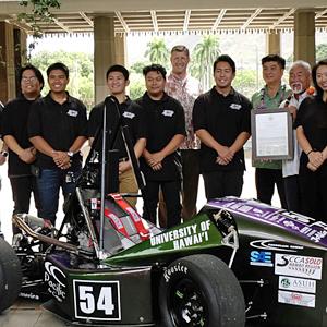 Rainbow Warrior Racing team with car