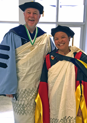 two people wearing commencement cloths and kihei