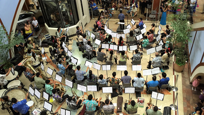 People playing instruments in a mall.