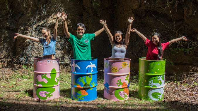 students standing in garbage cans