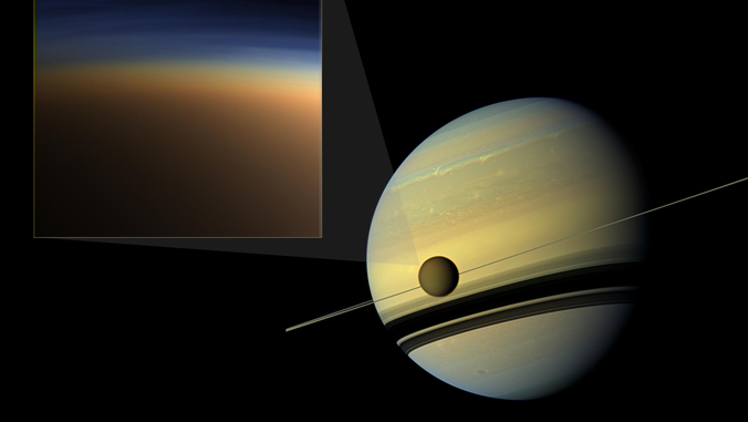 illustration of Saturn and Titan and an addition illustration of the haze around Titan