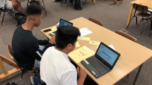two students using computers
