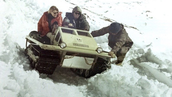 people riding on a snow mobile