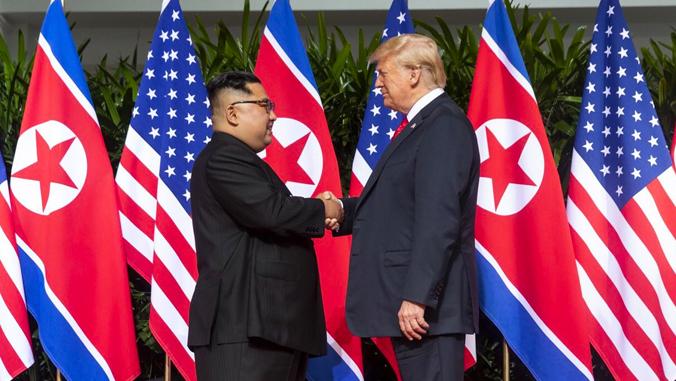 North Korean leader Kim Jong-il shaking hands with U.S. President Donald Trump.