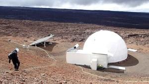 Researcher in space suit outside the HI-SEAS habitat