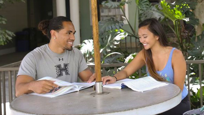 Male and female student studying.