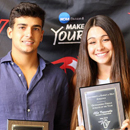 two people holding award plaque
