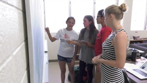 U H Manoa student mentor for Kalani High School students