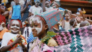 Child in colorful headdress