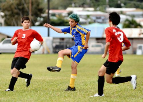 Hilo boys battle the St. Joseph's Cardinals during BIIF soccer action at St. Joseph school.