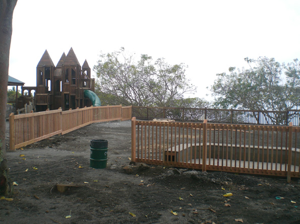 In the distance, the castle is renewed with multiple coats of sealant.  The 2,500 sq. ft. 1-5 yr old playground begins to take shape. (Photo courtesy of Cliff Kopp)