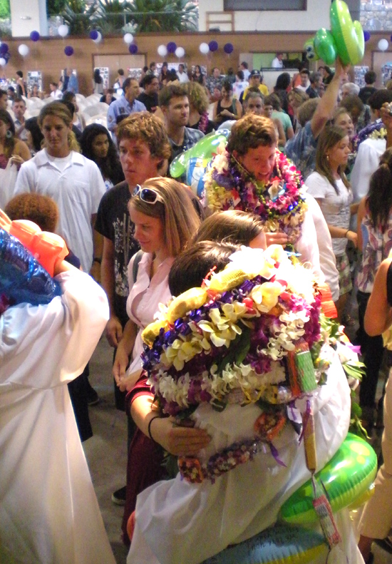 Friends, family and graduates congratulate each other following Saturday's graduation ceremony.