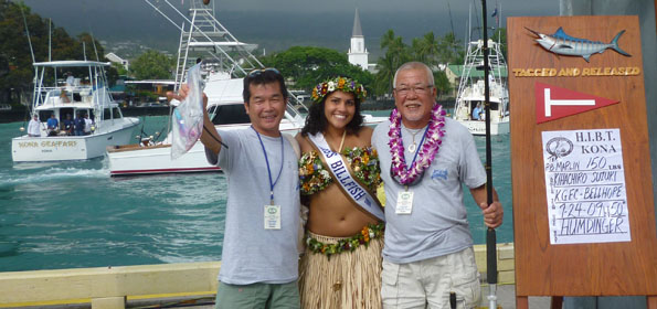 Kihachiro and Tetsuzo Suzuki pose for their championship photo with Miss Billfish 2009 Andria DeBina after Friday final day of fishing. (Photo courtesy of Current Events)