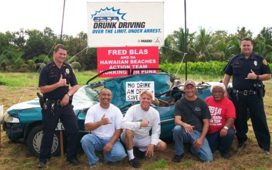 Community police officers and members of the Hawaiian Beaches Action Team prepare to educate the public about the hazards of unsafe driving.  Left to right: Officer Shawn Tingle, Gilbert Aguinaldo, Scott Kranson, Brian Keough, Fred Blas and Officer Sandor Finkey
