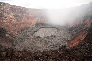 A small lava lake, confined by slightly elevated levees, is active at the bottom of Pu`u `Ō `ō crater. The lake is roughly the same size as a football field.