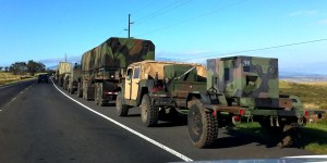 A military convoy pulls over onto the shoulder of Mamalahoa Highway (Hwy 190) to let traffic pass after exiting Saddle Road as it heads South to Waikolola Road. Hawaii 24/7 File Photo