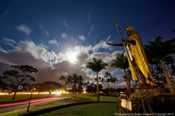 The moon rises over the Big Island as King Kamehameha the Great's statue reaches out from Hilo, Hawaii. Photo by Baron Sekiya | Hawaii 24/7