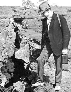 Ruy Finch, in charge of HVO during the explosive eruption, examining a crack related to the 1919 eruption that formed Mauna Iki. Photo courtesy of USGS/HVO
