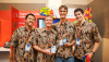 UH Hilo Team Poli`ahu (L-R): Wallace Hamada, Mike Purvis, Ryder Donahue, and Kayton Summers pose in front of their booth at the 11th worldwide Imagine Cup in St. Petersburg, Russia (photo courtesy of University of Hawaii at Hilo)