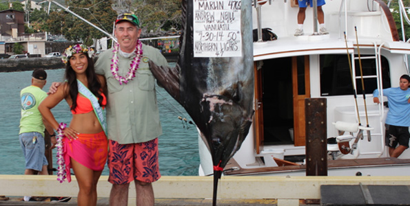 Miss Billfish Nicolette Noelani Palacol congratulates Angler Andrew Neill. (Hawaii 24/7 photo by Karin Stanton)