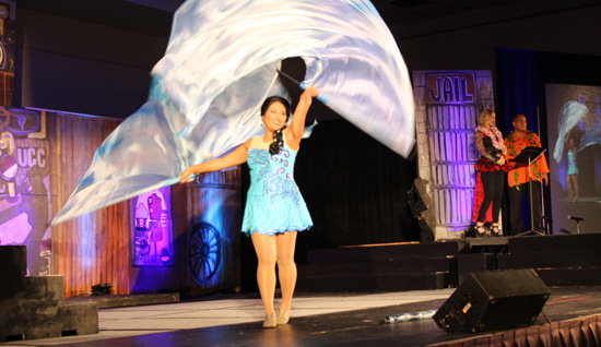 Ariel Enriquez performs a flag dance during the 2015 Miss Kona Coffee Scholarship Pageant. (Hawaii 24/7 photo by Karin Stanton)