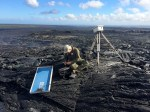An HVO geologist sets up a time-lapse camera to monitor the breakout on Puʻu ʻŌʻō. Photo taken Friday, February 27, 2015 courtesy of USGS/HVO