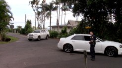 Police have Kahoa Street closed to traffic as they investigate an early morning shooting near Honolii Beach Park. Photography by Baron Sekiya | Hawaii 24/7