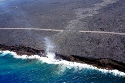 Just over two months since the start of the 61g flow, it reached the ocean on July 26 at 1:15 am HST. The narrow ocean entry was creating a small plume of gas and steam during today's overflight as the lava came into contact with the ocean. Photo taken Tuesday, July 26, 2016 courtesy of USGS/HVO