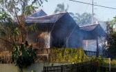 The smoldering remains of a house fire on Ohai Street Saturday morning (Jan 7). Photography by Baron Sekiya | Hawaii 24/7