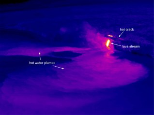 This thermal image shows the Kamokuna ocean entry. Two plumes of hot (scalding) water branch out from the entry point. The lava stream itself is the very hot feature right of center. Just above the lava stream, about 10 meters (yards) behind the sea cliff, is a narrow line of high temperatures that appears to be a hot crack. This hot crack suggests that the sea cliff around the entry point is unstable and has the potential to collapse. Photo taken Wednesday, January 25, 2017 courtesy of USGS/HVO
