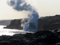 From the lava viewing area established by Hawaiʻi Volcanoes National Park, you can witness Kīlauea Volcano's ocean entry from a safe distance. With binoculars or a telephoto camera lens, spectacular views and photos are possible (as seen here)—without risking your life by entering the closed area. As lava streams into the ocean, explosive interactions between the molten lava and cool seawater hurl spatter and rock fragments skyward, often as high as the sea cliff, which is about 28 m (92 ft) high. Photo taken Wednesday, February 1, 2017 courtesy of USGS/HVO