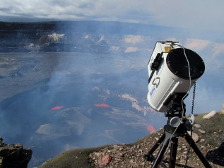 An FTIR instrument is set up on the rim of Halemaʻumaʻu Crater to measure volcanic gases from the summit lava lake. The open-path Fourier transform infrared (FTIR) spectrometer continuously measures the gases in a volcanic plume, measuring the relative abundance of each. Most of the gas emitted during a volcanic eruption is water vapor (H2O), carbon dioxide (CO2), and sulfur dioxide(SO2). Photo taken Sunday, February 12, 2017 courtesy of USGS/HVO