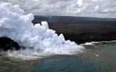 The Kamokuna ocean entry, with the laze plume blocking the view of the delta. The billowing white cloud rising from the ocean entry is a corrosive seawater plume laden with hydrochloric acid and fine volcanic particles that can irritate the skin, eyes, and lungs. Photo taken Monday, April 10, 2017 courtesy of USGS/HVO