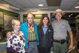 """Left to right: Elizabeth Fien, Executive Director of the Friends of Hawaii Volcanoes National Park; Dave Parker """"59er""""; , Margot Griffith, Executive Director of the Hawai'i Pacific Parks Association; and Hawaii Volcanoes' Acting Superintendent and Chief Ranger John Broward smile for a photo in the Kīlauea Visitor Center. NPS Photo by Janice Wei"""