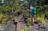 Visitor on Hiiaka and Pele hike at lava tree mold in Kahuku. NPS Photo by Janice Wei