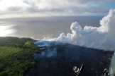 Lava from the Fissure 20 complex enters the ocean generating a white laze plume. Helicopter overflight on May 20, 2018, at 6:45 AM HST. Photo taken Sunday, May 20, 2018 courtesy of U.S. Geological Survey