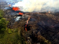 """Lava from the eastern channel of the Fissure 20 complex is flowing into a crack in the ground that opened on the morning of May 20, 2018. The crack is """"robbing"""" the easternmost channel of lava and the eastern ocean entry is therefore less vigorous than the western entry point. Photo taken Sunday, May 20, 2018 courtesy of U.S. Geological Survey"""