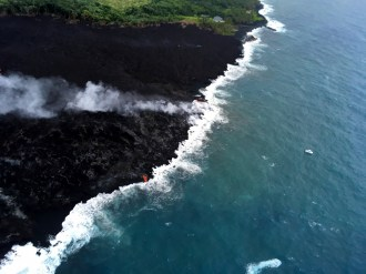 Scientists on the early morning overflight of Kīlauea Volcano's lower East Rift Zone documented a very weak ocean entry. For the easternmost lobe, only a few small finger channels of lava were entering the ocean. Photo taken Tuesday, May 29, 2018 courtesy of U.S. Geological Survey