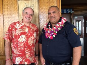 Mitch Roth, Hawaii County Prosecuting Attorney (left) and Officer Bryan Ellis.