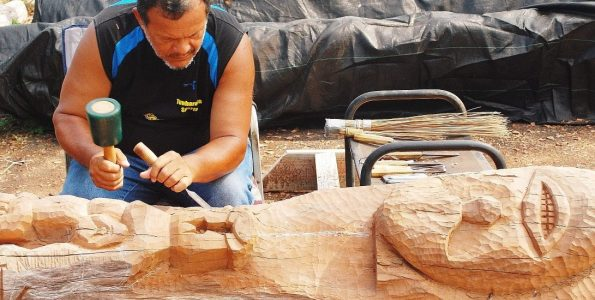 Carving Ki'i. Photo by James K. Kaulukukui Jr.