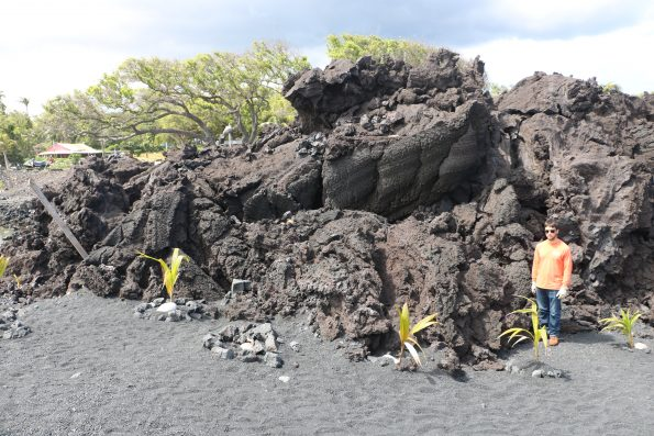 "HVO geologists (one shown here for scale) examined Kīlauea Volcano's 2018 lava flow near Isaac Hale Beach Park on March 29. This part of the lower East Rift Zone fissure 8 flow is mostly ""toothpaste lava""—an informal name for secondary spiny pāhoehoe lava that oozed out from the stalled primary 'a'ā flow that reached the coast. This lobe, classic toothpaste lava, is about 3-4 m (9–13 ft) thick and about 70 m (76–77 yds) long. USGS photo by M. Patrick."