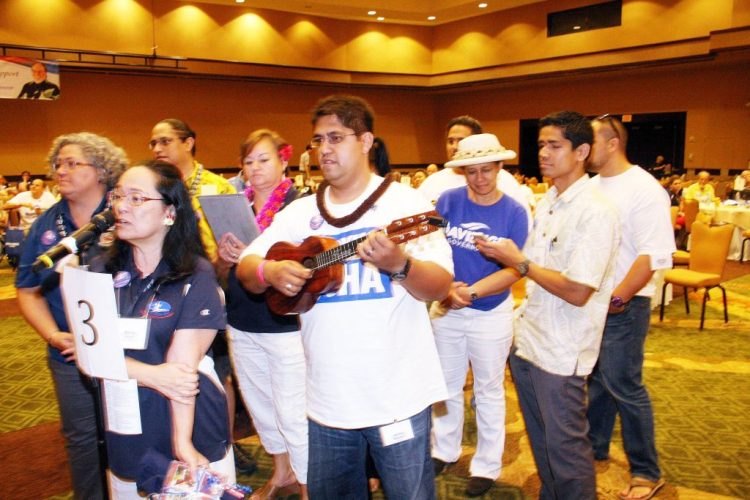 Hawaiian Affairs Caucus members serenade outgoing Democratic Party Chair Cante Carpenter at the 2014 State Democratic Convention.