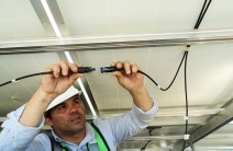 man installing wires