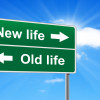 Sign signs new life one way and old life the other way, choose sustainable permaculture living