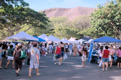 People walking around a local Oahu farmers market