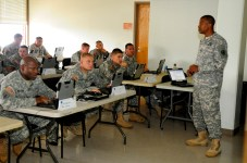 Staff Sergeant Vincent Moore, an instructor from the Aviation maintenance school in Fort Eustis, Va., navigates noncommissioned officers of the 25th Combat Aviation Brigade through the Unit Level Logistics System - Aviation Program during the Common Aircraft Maintenance Mobile Training Team course on Wheeler Army Airfield, Hawaii, May 20.